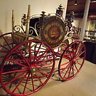 Classic Fire Engine, Hand-Drawn Hose Reel With 4-Wheel Steering, Circa 1857, New York City Fire Museum, New York City by lenspiro