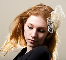 Redhead in cream fascinator and black top by Nick Dale
