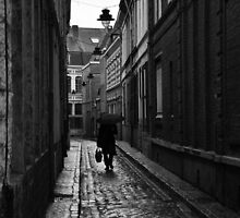 Man in the rain walking down alley by vkirbys