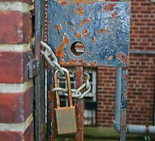 Rusty Lock on Wrought Iron Gate by Gilda Axelrod
