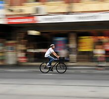 Brunswick st cyclist by Lucas D'Arcy