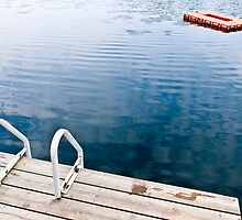 Dock on calm summer lake by Elena Elisseeva