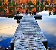 Wooden dock on autumn lake by Elena Elisseeva