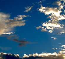 Beautiful Clouds And Blue Sky by Erik Anderson