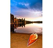Lake sunset with canoe on beach Photographic Print