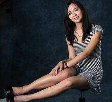 Pretty young lady in striped dress by photobylorne