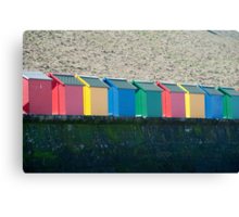 Colourful beach huts and Whitby sands Canvas Print