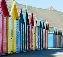 Row of colourful Beach huts by photoeverywhere