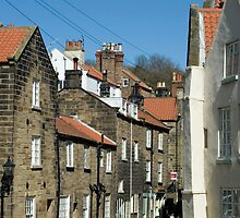 Narrow street in Robin Hoods Bay by photoeverywhere