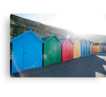 Brightly coloured beach huts Canvas Print