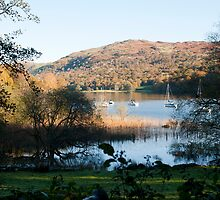 Yachts moored in Coniston Water in Cumbria by photoeverywhere