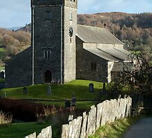View down a country lane of Hawkshead church by photoeverywhere