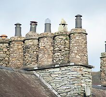 Cylindrical stone chimney pots by photoeverywhere