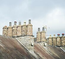 Traditional cylindrical stone chimney pots by photoeverywhere