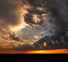 DRAMATIC SUNSET by Sandra  Aguirre