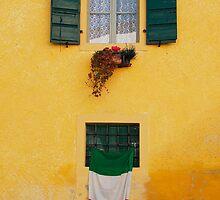 Italian Flag on Yellow Building by jojobob