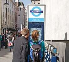 Visitors look at a West End cycle hire map by Keith Larby