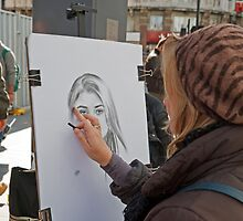 An artist at work in Leicester Square London by Keith Larby