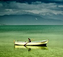 boat in egirdir lake by gzmguvenc89