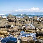 Beach, stones, waves. and Moloka'i by Robert Kelch, M.D.