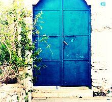 blue door in bodrum narrow street by gzmguvenc89