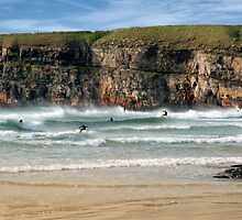 surfers competition near cliffs by morrbyte