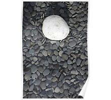 lone white stone amongst many grey pebbles Poster