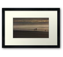 Horse rider on misty beach Framed Print