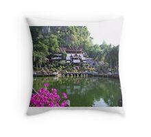 Buddhist monastery with water garden beneath cliffs Throw Pillow