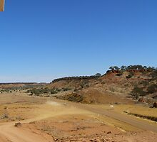 The narrow sealed road from Boulia, Cawnpore lookout. Cent. Que. by Rita Blom