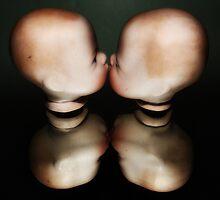 Kiss - Two Dolls Heads Kissing. by Kim-maree Clark