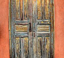A rustic looking double door in Santa Fe, New Mexico by Ken Smith