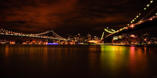 The Manhattan and Brooklyn Bridges at Night by Chris Lord