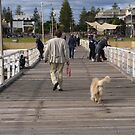 Retriever following his owner off Henley Beach Jetty, Adelaide. S.A. by Rita Blom