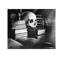 Skull and spell book design by Tom Conway