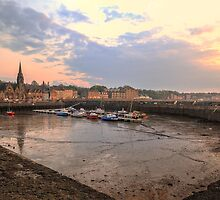 The sun begins to set over Newhaven Harbour, Edinburgh by Miles Gray