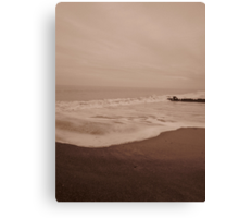 Hornsea beach with wave coming in Canvas Print