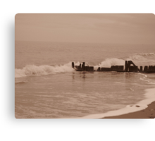 Wave crashing against breaker Canvas Print