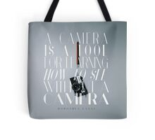"""""""A camera is a tool for learning how to see without a camera."""" – Dorothea Lange Tote Bag"""