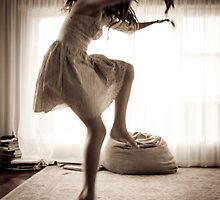 Girl dancing in Sunlit room by Kim-maree Clark