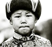Young boy during Nadaam festival, Ulaanbaatar, Mongolia by jennyjones
