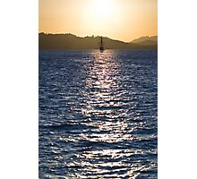 Sailboat bathed in dawn sunlight Photographic Print