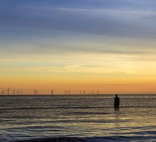 Windfarm at sunset by Paul Madden