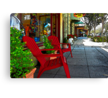 Chairs On A Sidewalk Canvas Print