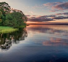 Lake Sunrise - the summer sun rises over a lake in southern Sweden. by eXparte-se