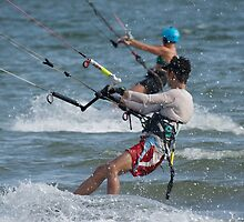 Two kite surfers racing in same direction by Nick Dale