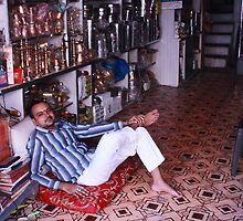 Reclining Shopkeeper Begum Bazaar Hyderabad by Andrew  Makowiecki