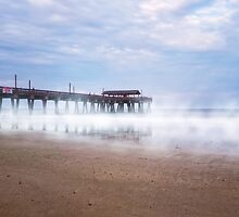 Mists Beneath Tybee Pier by Mark Tisdale