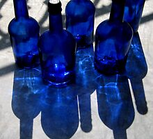five blue bottles by Caroline  Peacock