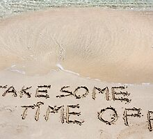 TAKE SOME TIME OFF written on sand on a beautiful beach, blue waves in background by Stanciuc